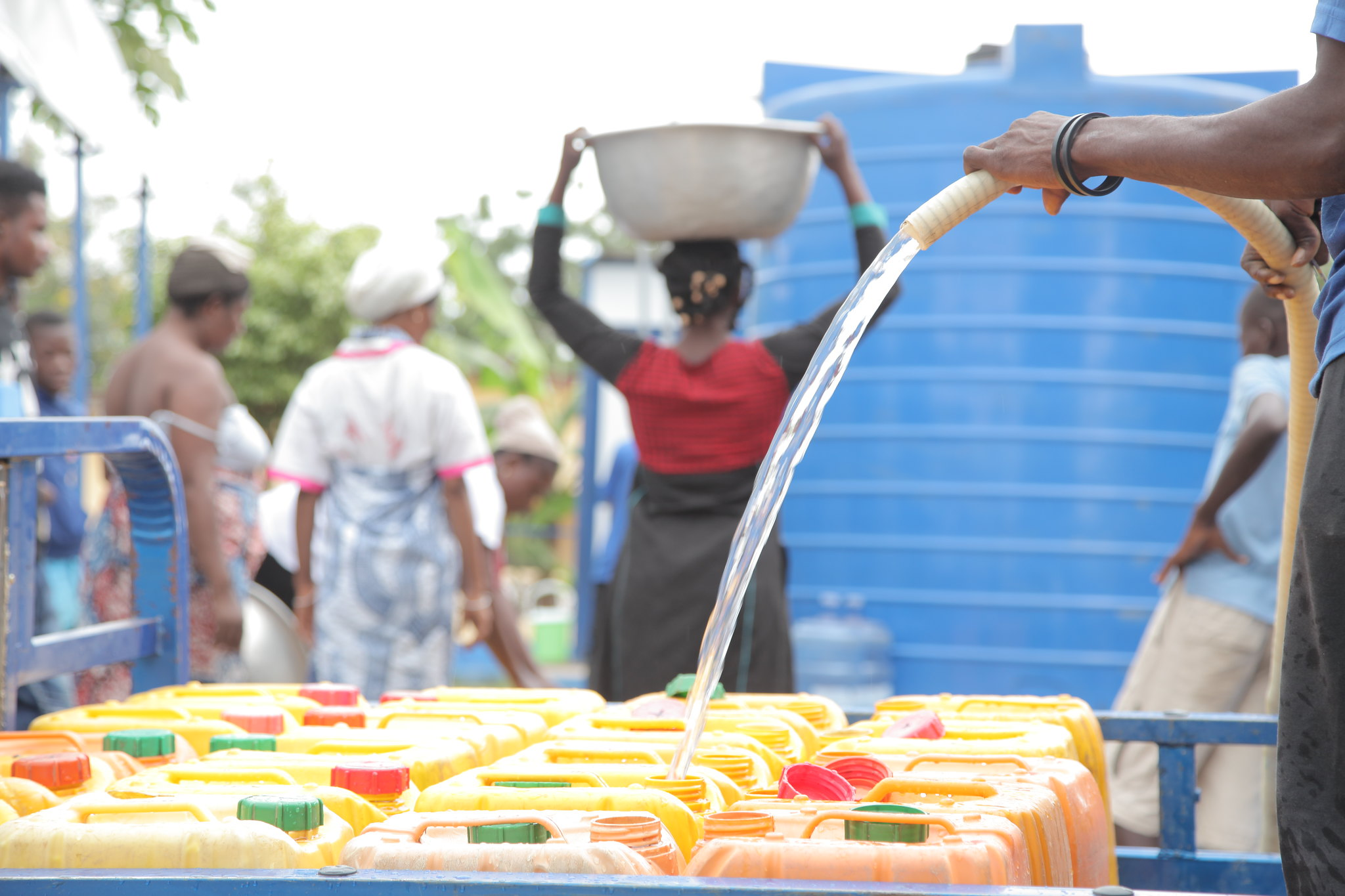a primary school pupils in Kakamega County draw clean water from a well.