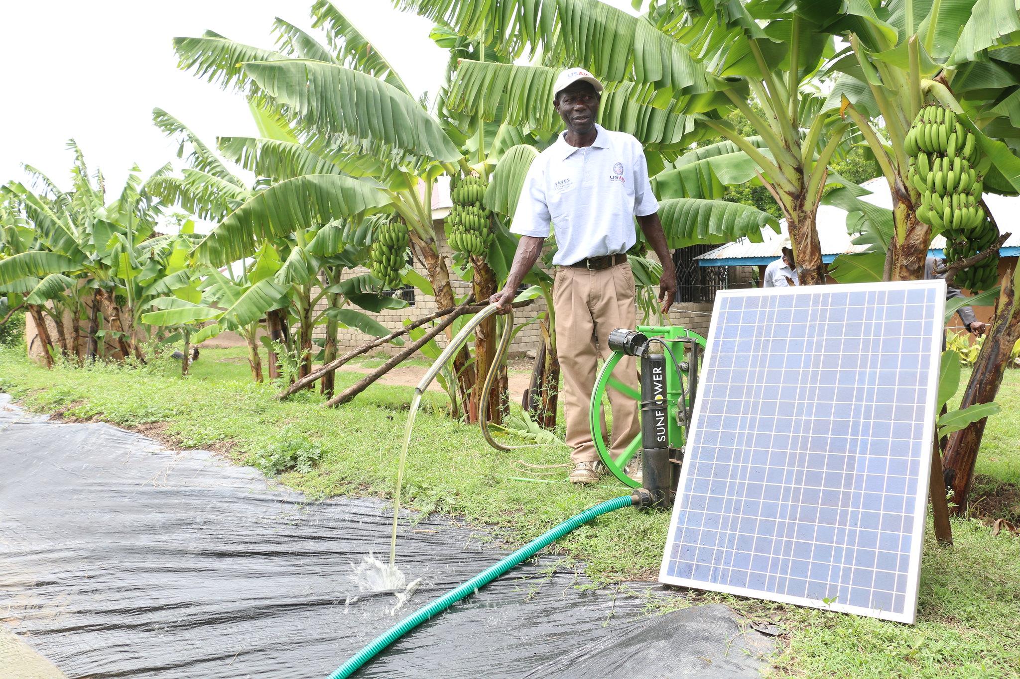 In photo: Joshua Okundi in Homa Bay County demonstrates usage of a solar pump.