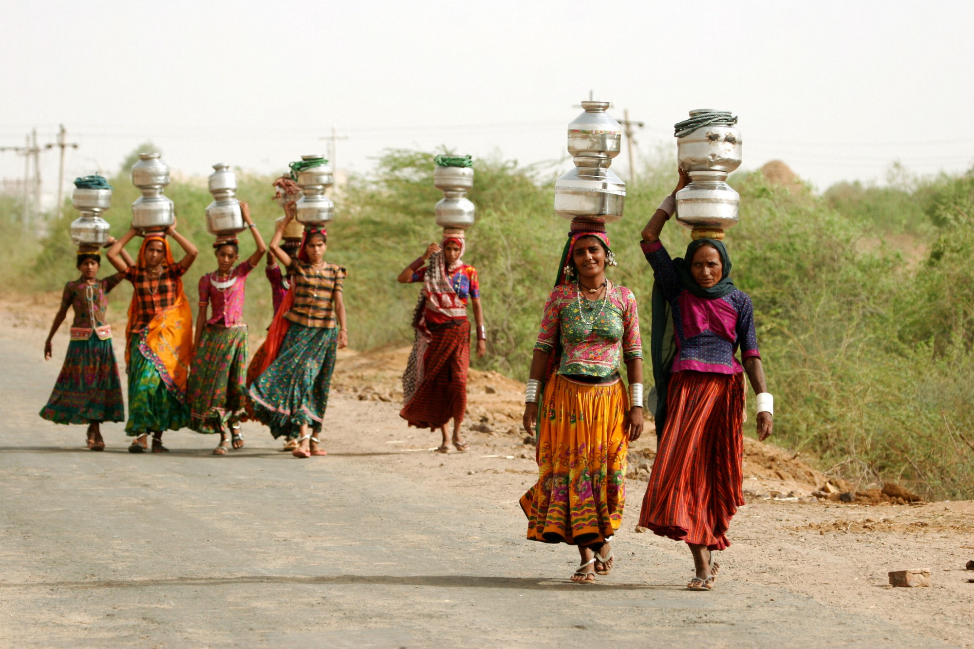 women carrying water in India
