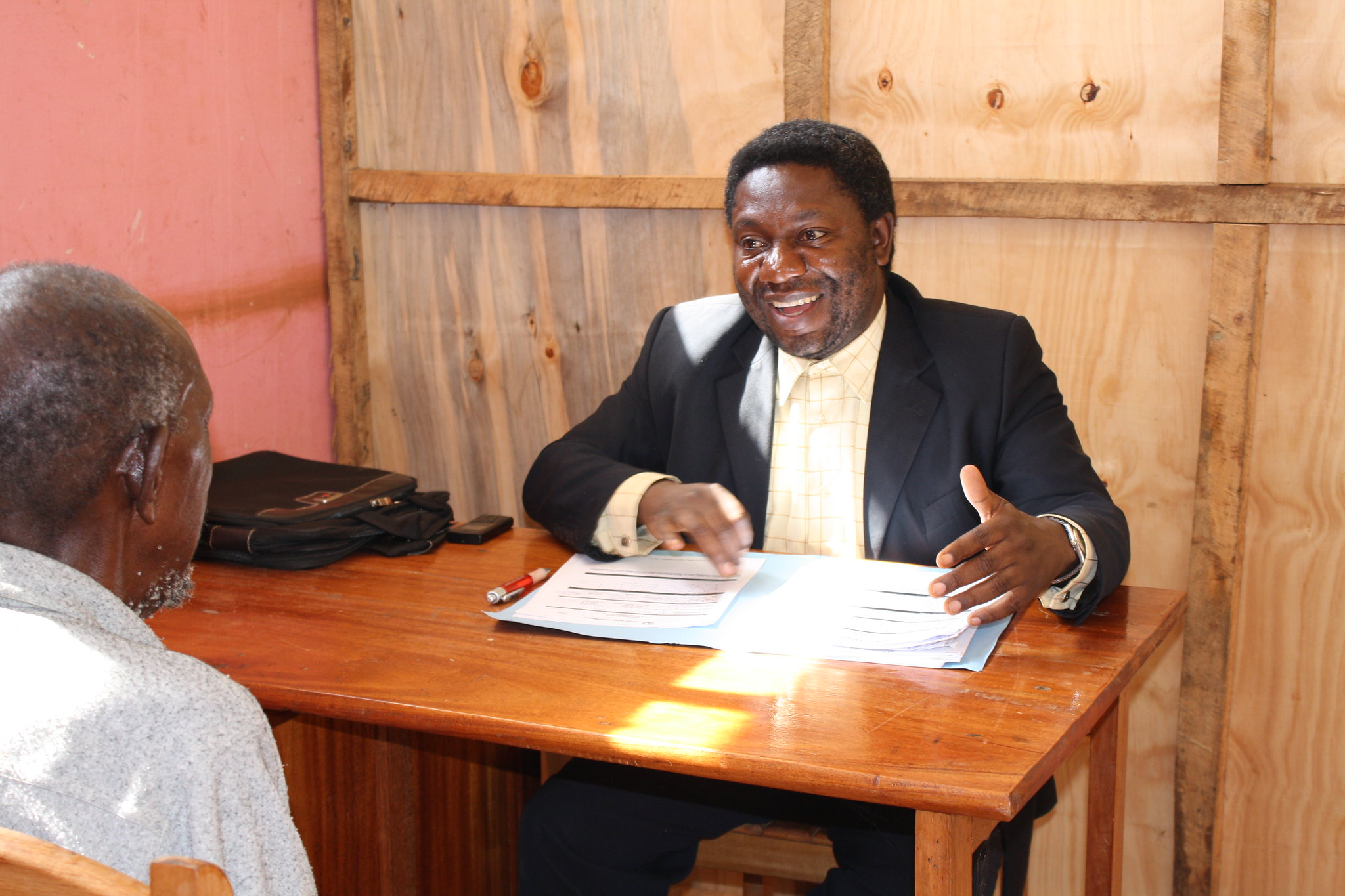 Mwenga is a local lawyer who volunteers his time and expertise at a free legal clinic near South Kivu