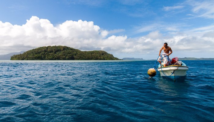Man With Boat in Micronesia