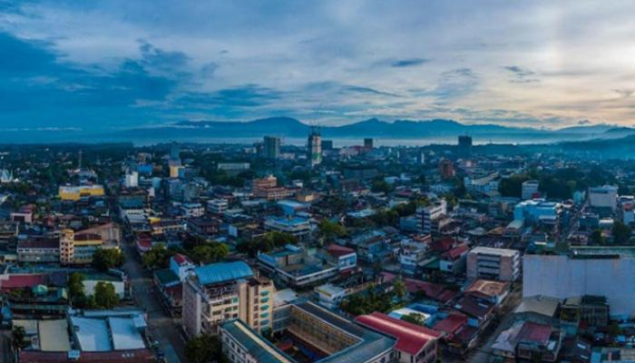 View of Cagayan de Oro City, Philippines, with ocean and mountains in background