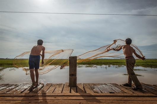 Residents in Pursat province, Cambodia, cast fishing nets.