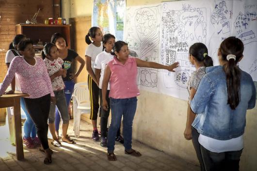 Young women from the Ita Guasu indigenous community in Paraguay, participate in the development of their community development plan.