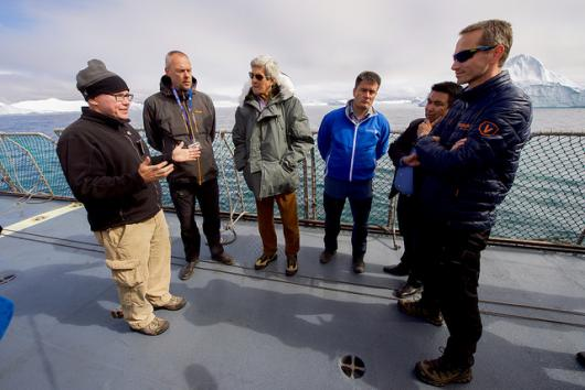 Climate scientists brief Secretary Kerry as they cruise the waters off Ilulissat, Greenland.