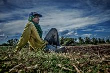 Worker takes a break while planting sugar cane, Negros Occidental, Philippines