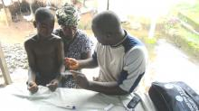 Testing for Malaria in rural Guinea.