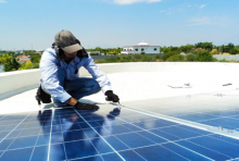 Man working on solar photovoltaic panel