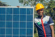 Man holding solar panel