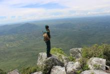 A game ranger looks out over Nkhotakota Wildlife Reserve
