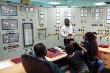 Inside a hydropower control room in Tanzania.