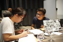 "John Fredric Bugayon working with illustrator Weng Nunez on bringing ""Strawla"" to life through illustration."