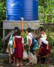 Children gather at a cistern in Kananga, in the Leyte Province of the Philippines