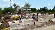 Victims of flooding in Mozambique seek to recover their belongings