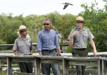 President Barack Obama walks the Anhinga Trail with rangers at Everglades National Park.