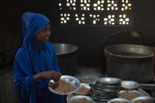 A student in Somalia receives a nutritious cooked meal