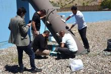 Staff of the Soran Water Directorate measure the water flow through a main distribution pipe