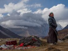 A woman sets up shop with her wares at more than 14,000 feet in the Nepalese Himalaya, near Lungden