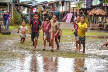 Children running in the rain