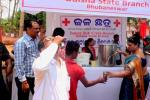 Indian Red Cross Society gives out water in Bhubaneswar city.