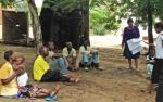 Community members in Malawi discuss climate change impacts.